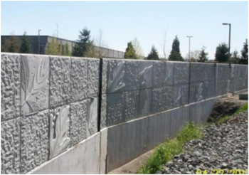 The King County Flood Control District, together with the cities of Kent and Tukwila, are choosing floodwalls and rip-rap bank armoring instead of sustainable levee designs that provide room for trees to shade the river. Image: Floodwall on Boeing Levee, completed 2013. | City of Kent, WA