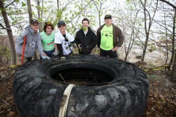Volunteers show off their big find at the 4th Annual Black River Clean-up. | Stephanee Moore Koscho