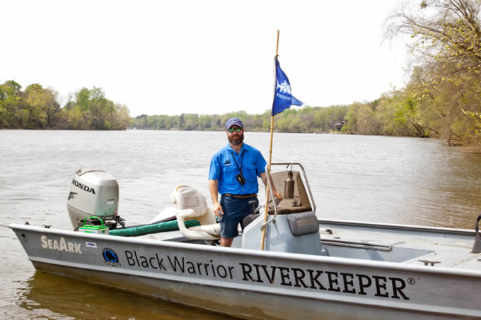 Black Warrior Riverkeeper Nelson Brooke on in the river in the patrol boat near Tuscaloosa. | Photo by John Wathen, Hurricane Creekkeeper