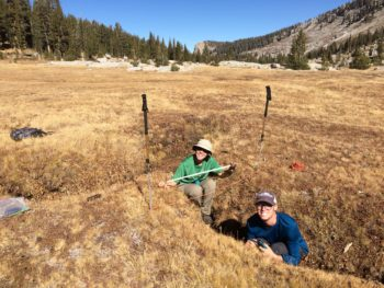 AmeriCorps member Rachel Friesen and American Rivers volunteer Carson Clark measure a large gully as part of a meadow assessment in Kings Canyon National Park. | Maiya Greenwood