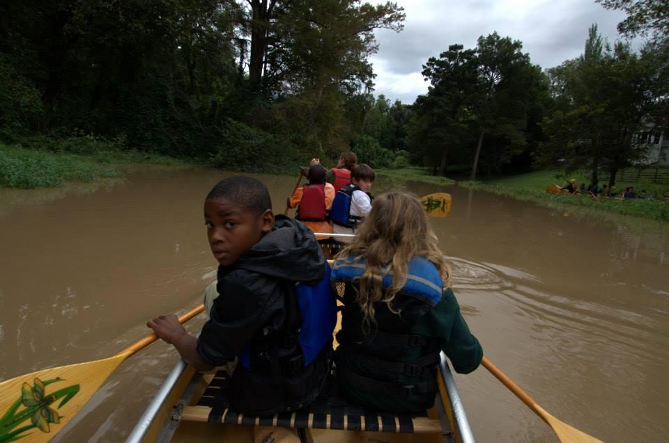 Children canoe the endangered Big Sunflower River in Coahoma County, Mississippi