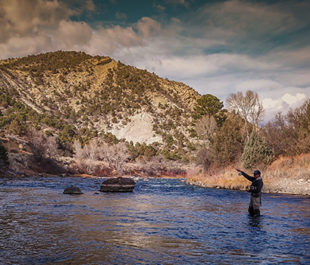 Man fishing on the Animas River. | Sinjin Eberle