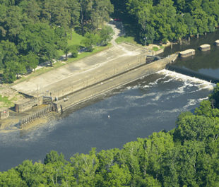 Lock and Dam #3. South Wings volunteer pilot Hap Endler flew up the Cape Fear River for photographs of Eagles Island and the Battleship North Carolina, the State Port at Wilmington and its wood pellet operation and the three Locks and Dams between Wilmington and Fayetteville. Photo by Alan Cradick, overflight provided by South Wings, June 15, 2015.
