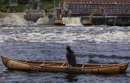 Joseph Dana paddles a traditional handmade birch canoe on the Penobscot River and watches as the Veazie Dam is breached in Eddington, Maine. Photo: Jessica Rinaldi, Boston Globe