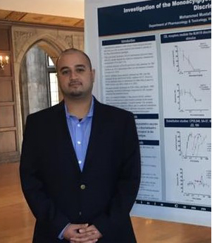 Mohammed Mustafa presenting a poster on his research
