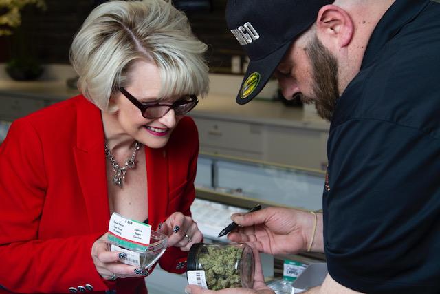 Nikki Lawley inspecting cannabis