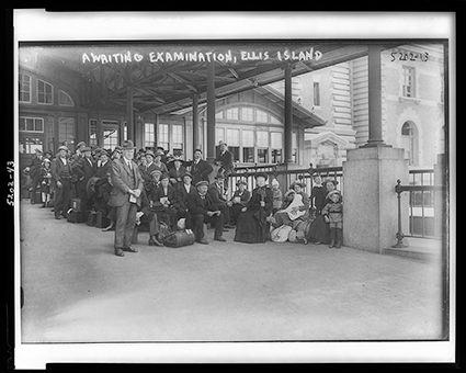 Awaiting examination, Ellis Island. Ellis Island New Jersey New York, ca. 1907. [Between and 1921] Photograph. Retrieved from the Library of Congress.