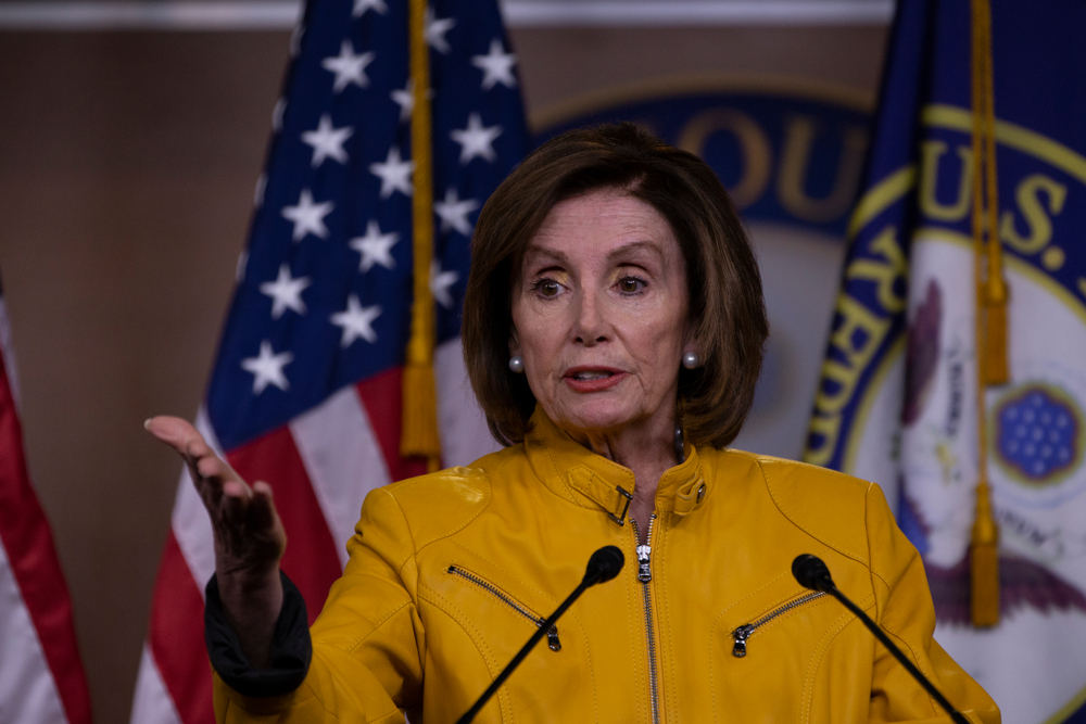 Nancy Pelosi conducts her weekly press conference