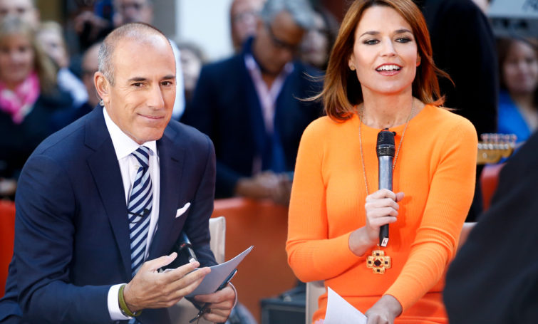 NEW YORK-SEP 23: TV personality Matt Lauer and Savannah Guthrie attend the performance by Cher on NBC's Today Show at Rockefeller Plaza on September 23, 2013 in New York City. - Image