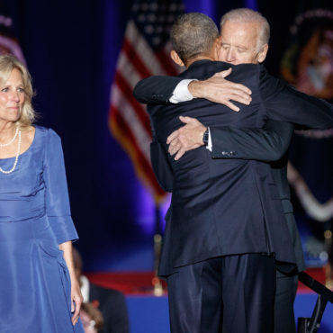 U.S. President Barack Obama hugs Vice-President Joe Biden as his wife Jill woks on after Obama delivered a farewell address at McCormick Place in Chicago, Illinois, U.S. January 10, 2017. - Image