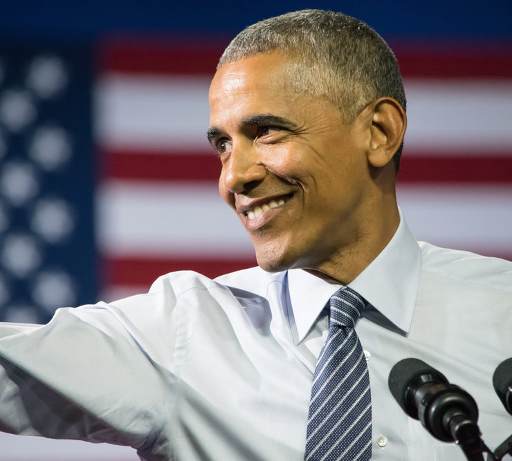 CHARLOTTE, NC, USA - JULY 5, 2016: Barack Obama President of the United States gestures an extended arm toward the crowd during a speech at the Charlotte Convention Center with Hillary Clinton. - Image