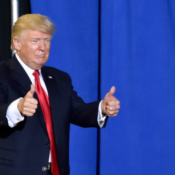 HARRISBURG, PA - APRIL 29, 2017: President Trump giving a two thumbs up gesture as he exits the stage of his campaign rally. Held at The Farm Show Complex and Expo Center. - Image