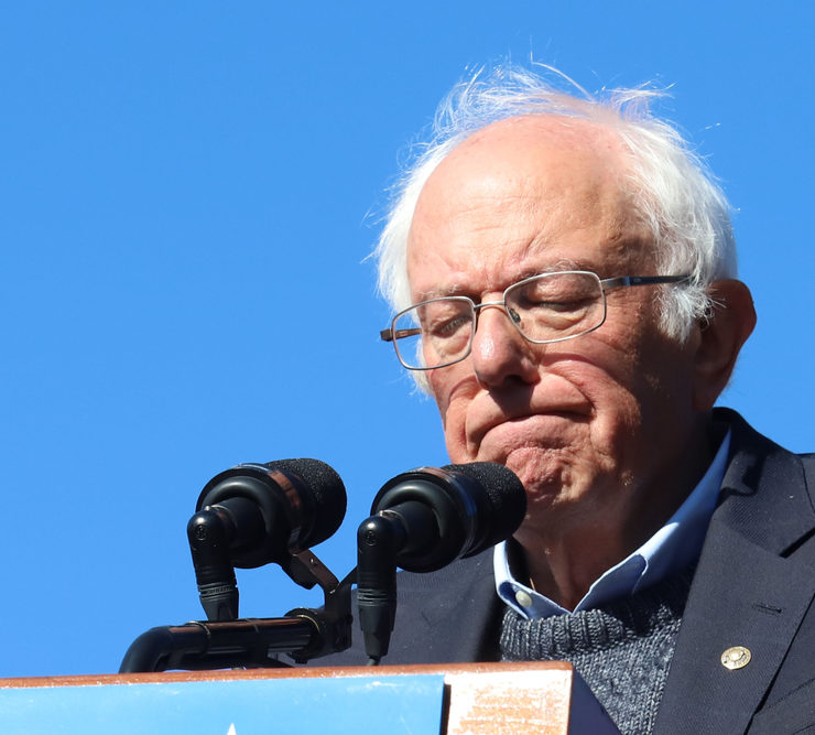 """NEW YORK - OCT 19, 2019: Democratic presidential candidate Bernie Sanders appears on stage during the """"Bernie's Back Rally"""" at Queensbridge Park in Long Island City on October 19, 2019, in New York."""