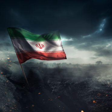 Iran flag waving with hope after a disaster. / high contrast image