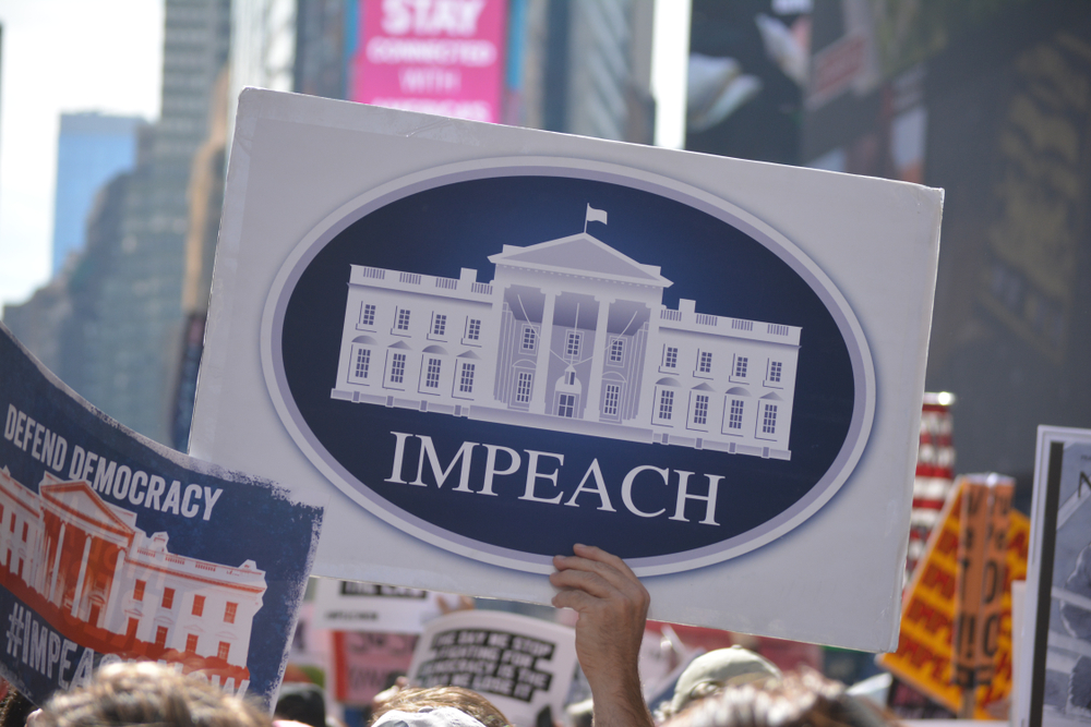 New York City, October 13, 2019: Rally calling for impeachment proceedings against President Trump in Times Square in Midtown Manhattan.