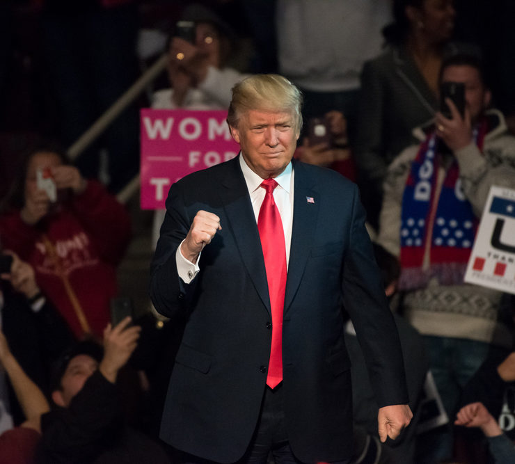 "HERSHEY, PA - DECEMBER 15, 2016: President-Elect Donald Trump gives a ""Fist Pump"" to the crowd as he arrives on stage to deliver a speech at a ""Thank You"" Tour rally at the Giant Center."