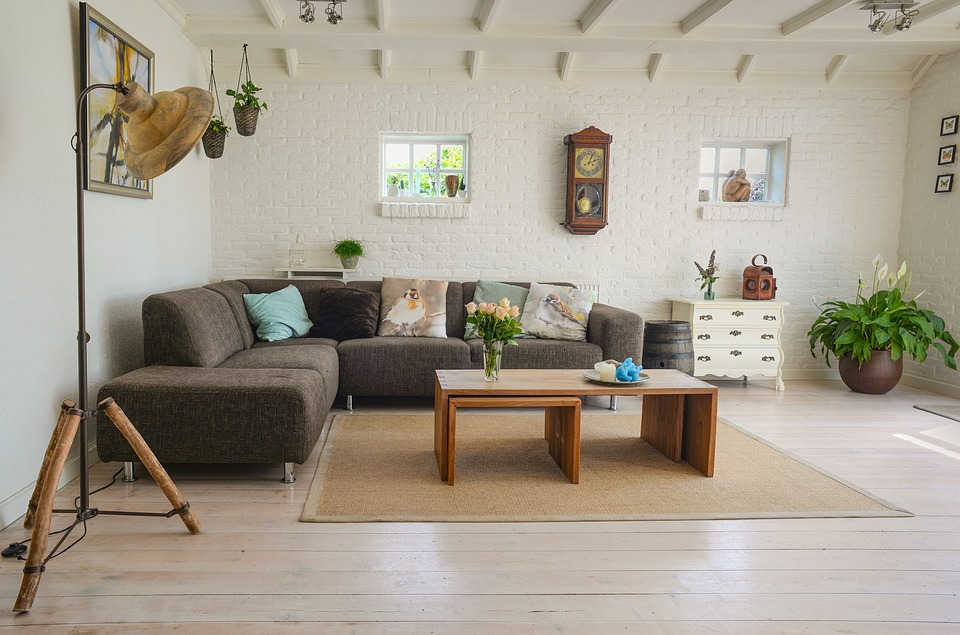 A living room with a couch, table, and decorative pieces