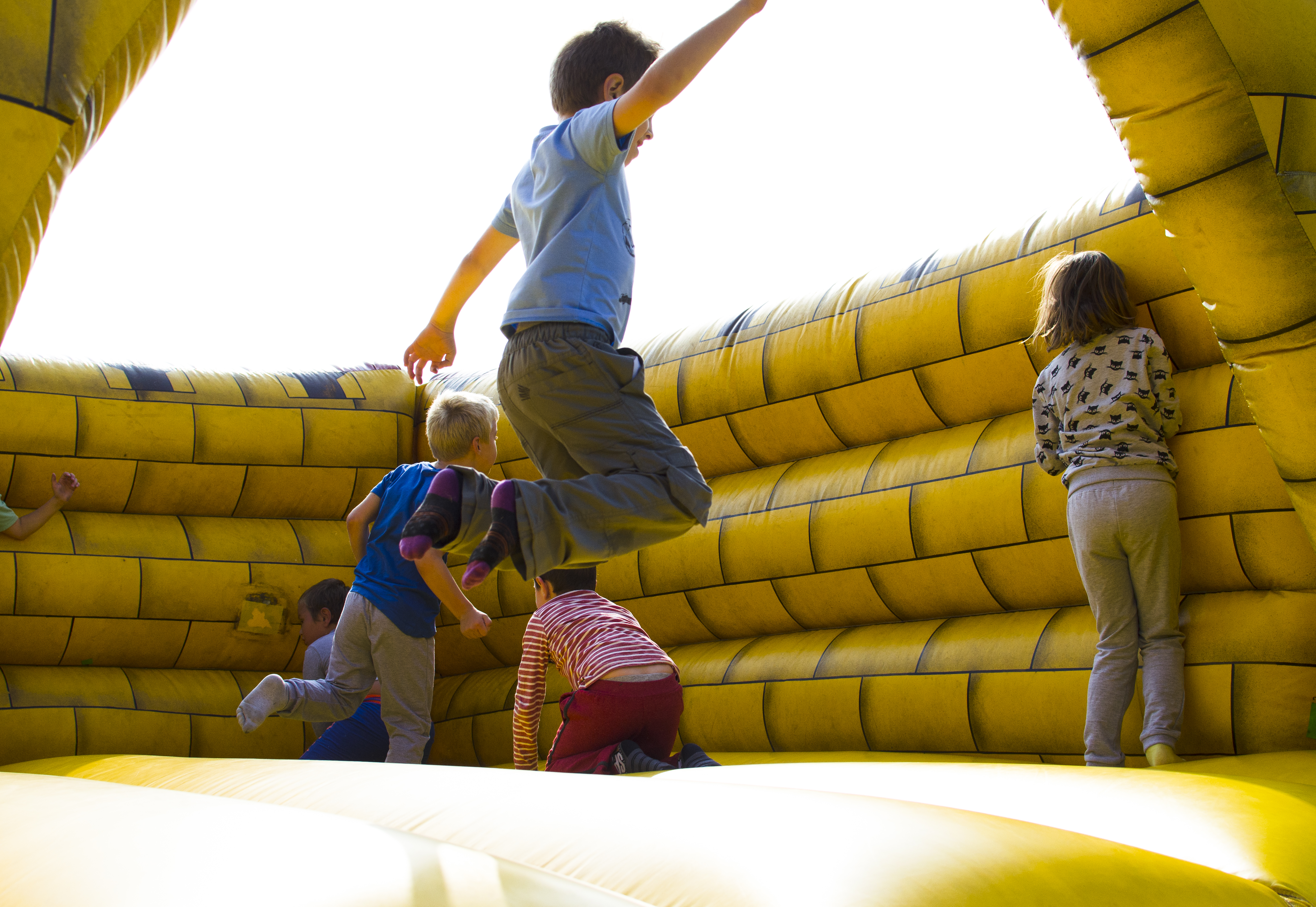 Kids jumping and playing in a bouncy castle