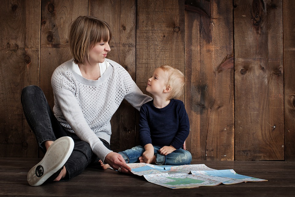 A mother and child sitting on the floor