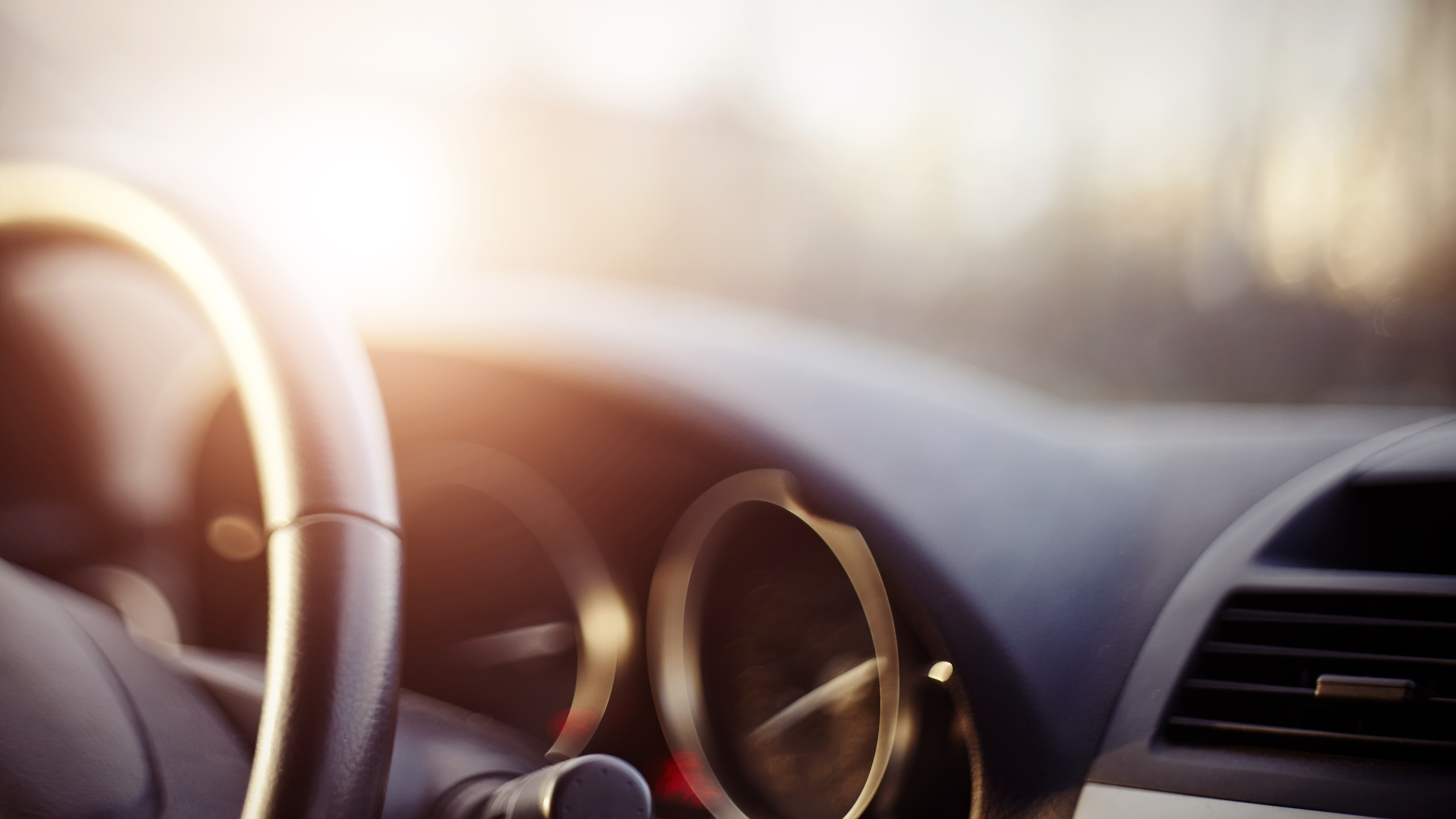The steering wheel and dashboard of a car