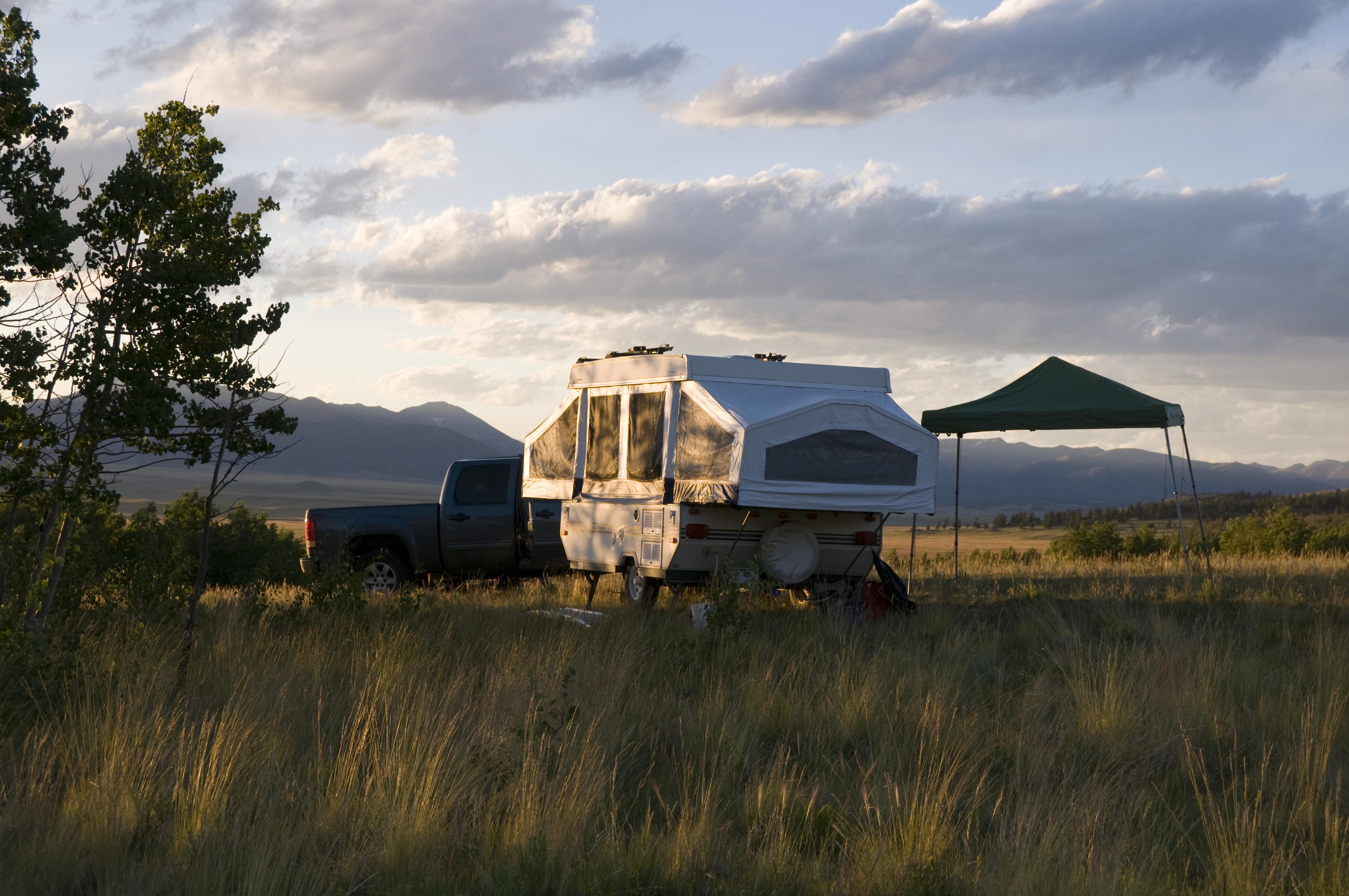 A pop-up camper in a field