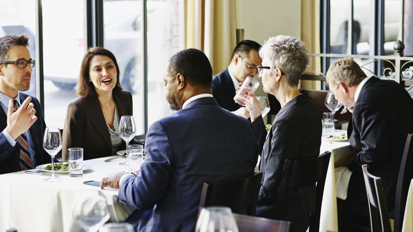 What Should One Include in the Wording of a Business Dinner Invitation?
