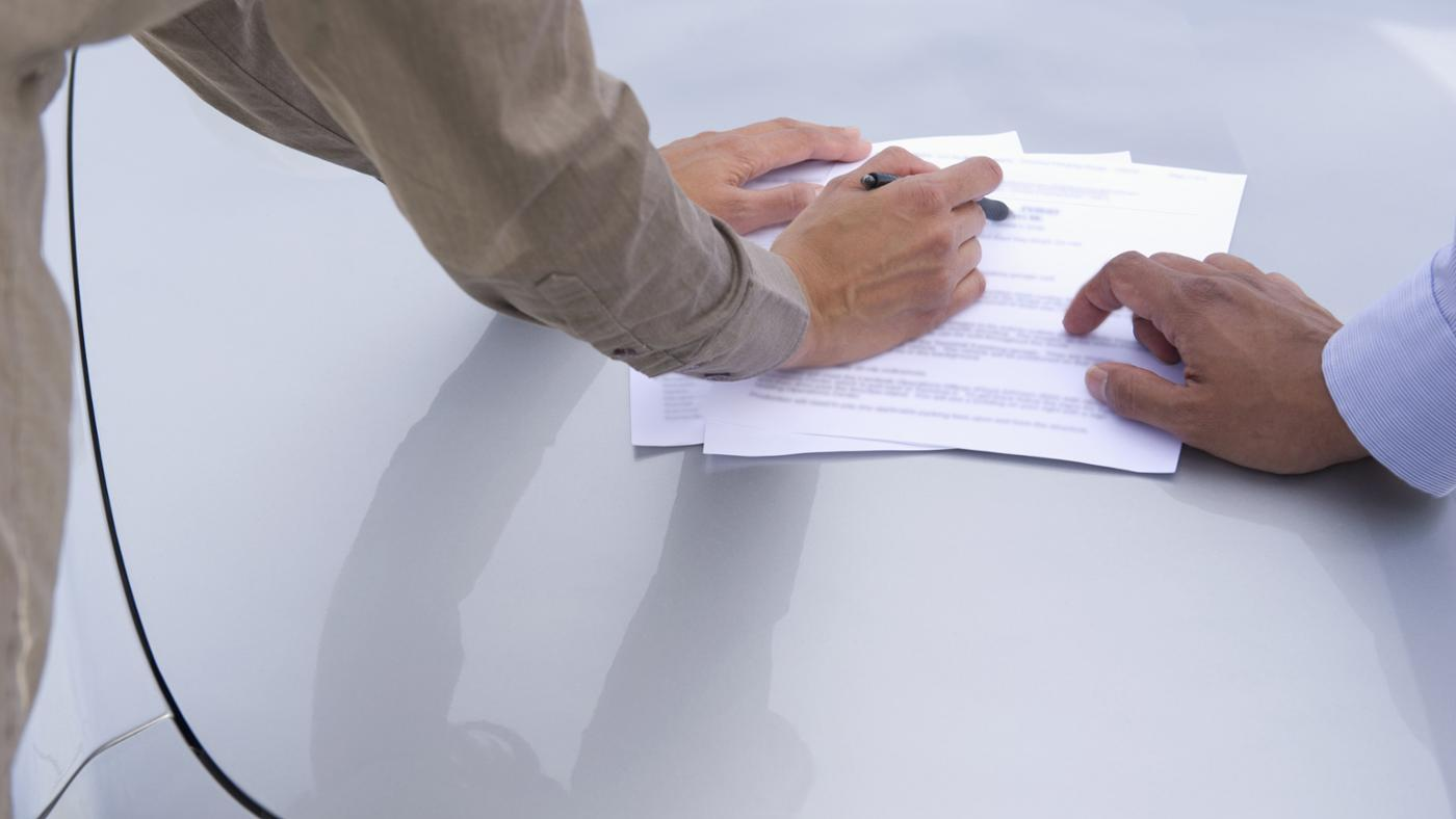 How Do You Sign a Car Title Over to Someone Else?