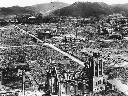 black and white photograph of an aerial view of Hiroshima, with a church in the foreground