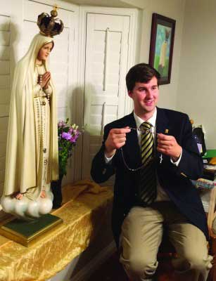 Custodian Kenneth Murphy with Statue of Our Lady, getting ready to lead the rosary at a Fatima Home Visit