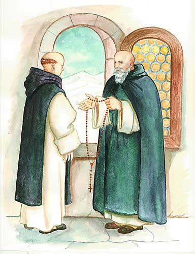Father James gives Brother Angelo a rosary