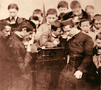 St John Bosco - photograph - hearing confession