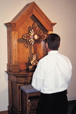 Kneeling before the Blessed Sacrament