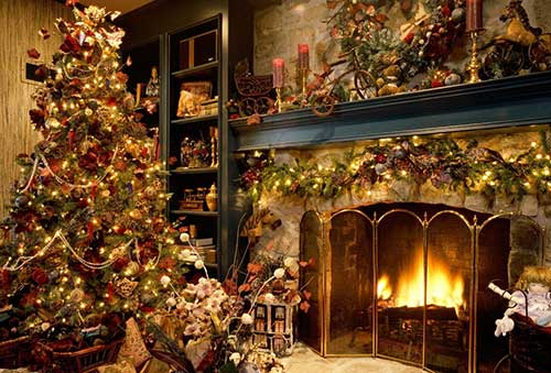Old fashioned Christmas tree and a roaring fireplace.