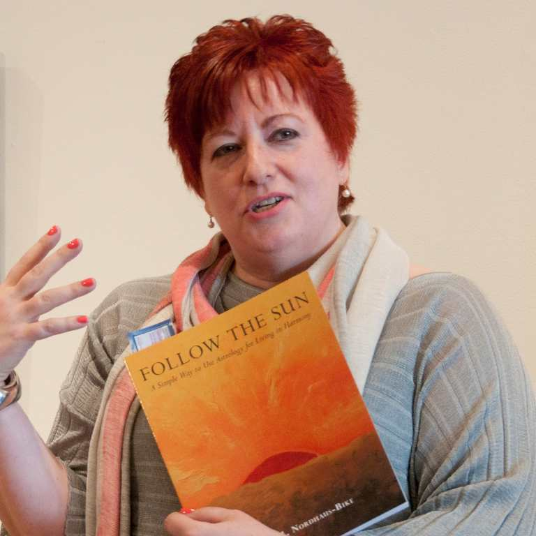 Anne Nordhaus-Bike speaking at Follow The Sun astrology book signing