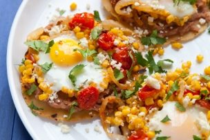 Tomato and Corn Tostadas with Baked Eggs