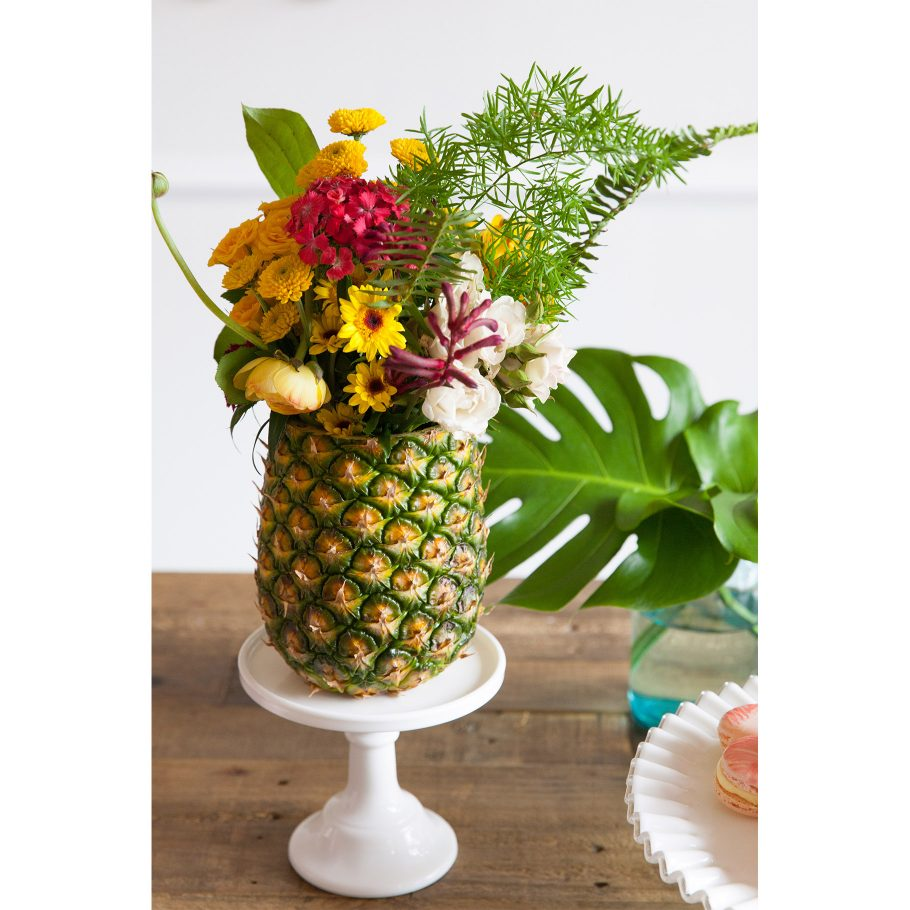 Bright florals + pineapple vases