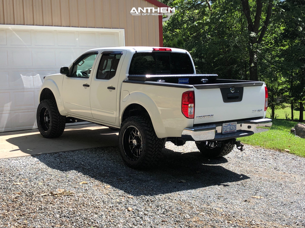 10 2014 Frontier Nissan Rough Country Suspension Lift 6in Anthem Gunner Machined Accents