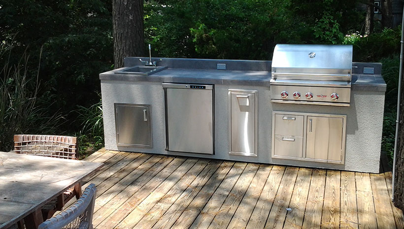 Pre built set in place islands affordable outdoor kitchens for Pre built garden rooms