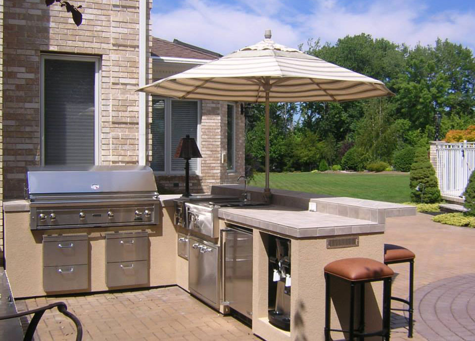 Pre built set in place islands affordable outdoor kitchens for Pre built outdoor kitchen islands