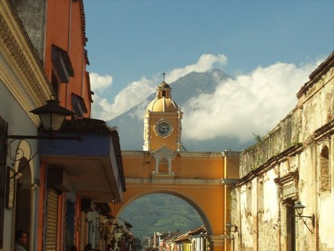 Just walking down the street in Antigua, the fiery volcano looms in the distance, a stark contrast to the quaint colonial setting.
