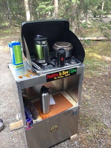 Camp stove and stand in action at Lake Louise campground