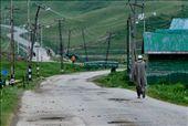 A man walks down a road in Gulmarg, while talking on the phone. : by 20supriya, Views[187]