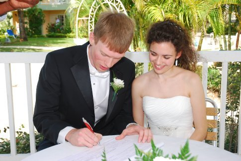 Signing the wedding certificate after the ceremony.  It's offical, we're married!!!