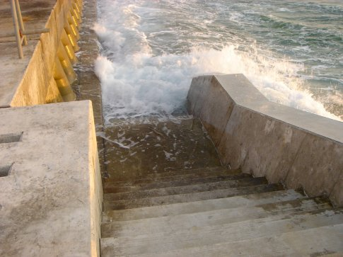 Stairs down to the sea from the Sea Wall.  Divers often use these stairways, just maybe not when the tide is coming in like in this photo.
