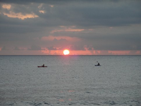 Kayakers chasing the sun.