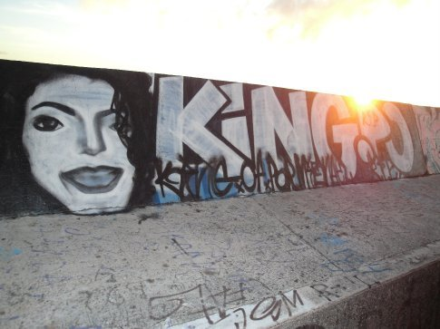 Someone (or more likely several someones) went through and painted graffiti over a lot of the paintings on the Sea Wall recently.  Someone did, however, put up a tribute to the late King of Pop.