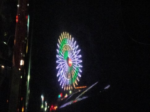 Reflection of the Mihama Ferris Wheel on the side of Brandon's SMX.  I thought it looked cool.