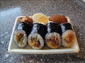 Sushi with a piece of fried chicken, half a hard-boiled egg, and a curry-flavored piece of tonkatsu.  Yummy!: by abcarlson, Views[1294]