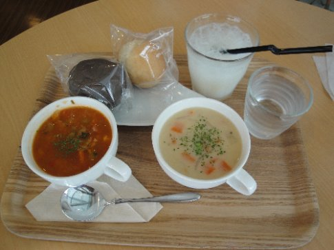 Megumi's lunch - minestrone soup, clam chowder, a squid ink roll, a butter roll, and