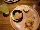 I had potatoes and carrot in the black bowl, some sort of sweetened potato paste in the white dish, a piece of chicken, and some doria.  I am in love with the Okinawa orange/lemon juice!  It was wonderful and refreshing!: by abcarlson, Views[358]